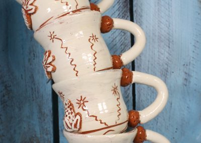 stack of hand made pottery mugs by herefordshire maker sarah monk ceramics