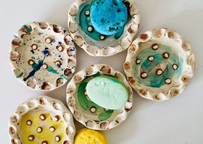 a selection of handmade soap dishes by sarah monk ceramics plus a selection of shampoo bars