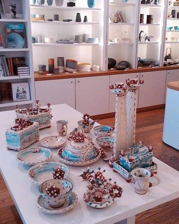 a selection of sarah monk ceramics on a display table at contemporary ceramics centre