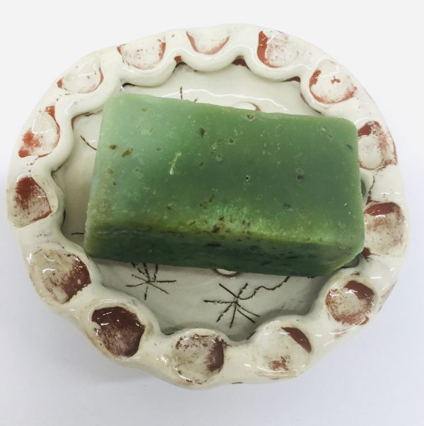 white circular soap dish with green soap by sarah monk ceramics