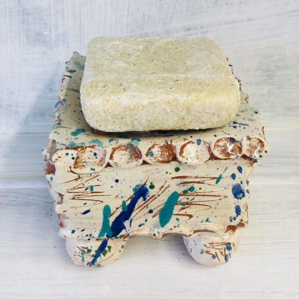 aerial view of square soap pillow with splatters and sgraffito scribbles