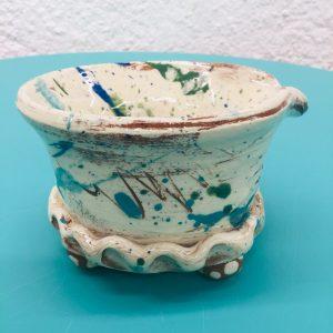 slipware soap colander with white slip and scribbles