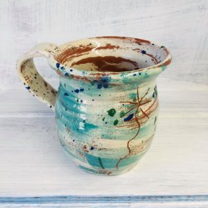 hand thrown mug by sarah monk ceramics in brushed teal with sgraffito daisy