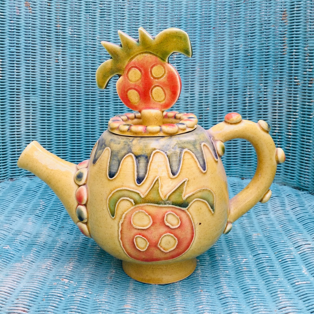 yellow earthenware teapot with red fruit design made by sarah monk 1995