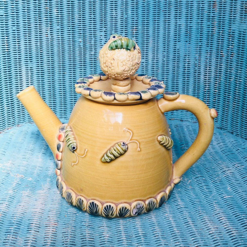 yellow pottery teapot with green bugs hand thrown and decorated by sarah monk ceramics