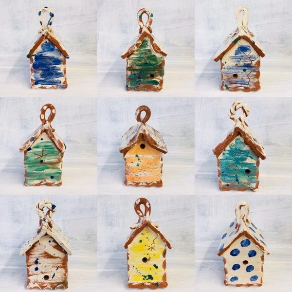 A montage of nine photos of bug houses made by sarah monk in a selection of different colours