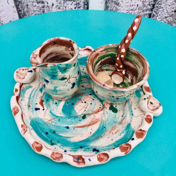 ceramic tea tray with milk jug and sugar bowl in teal slipware by sarah monk ceramics