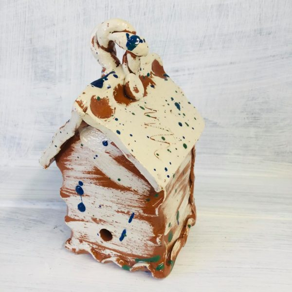 top view of white slipware bughouse by sarah monk